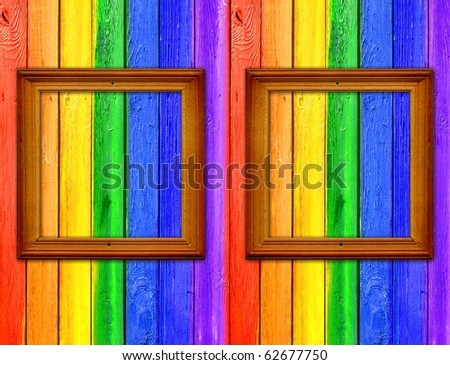 Vintage Gallery: Rainbow scrapbooking background - painted fence with two wooden frames - stock photo