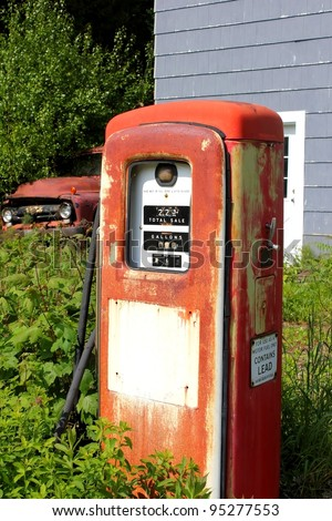 vintage gas pump and truck at an abandoned location - stock photo