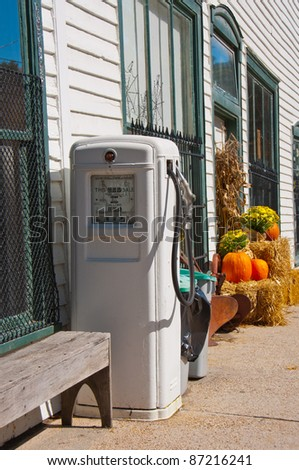 Vintage gas pump offering 99 cents per gallon gas. Retro gas pump outside an old store in North Carolina. - stock photo