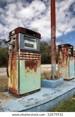 Vintage gas pumps, icons of an era to be extinct. - stock photo