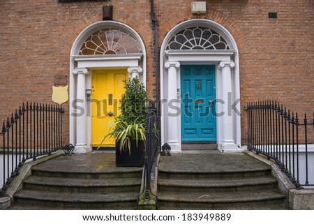 Vintage Georgian doors in yellow and turquoise in Dublin - stock photo