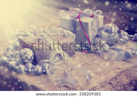 vintage gift box package, Birthday Christmas gift boxes with blue and pink ribbons on wooden background.