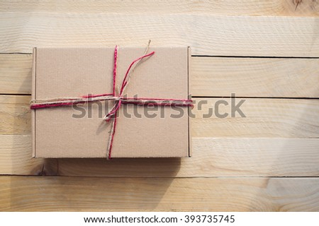 Vintage gift box package  on old wooden background. - stock photo