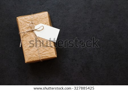 Vintage gift box tied with rope on a gray stone background