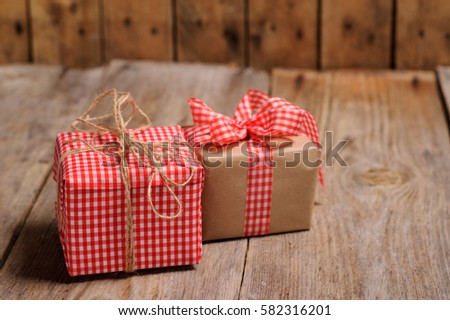 Vintage gift box with ribbon on wooden background