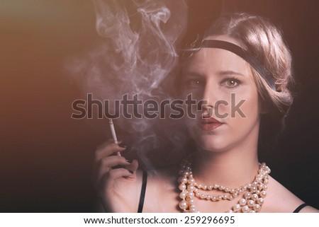 Vintage girl smoking cigarette - stock photo