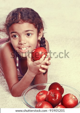 vintage girl with red apples - stock photo