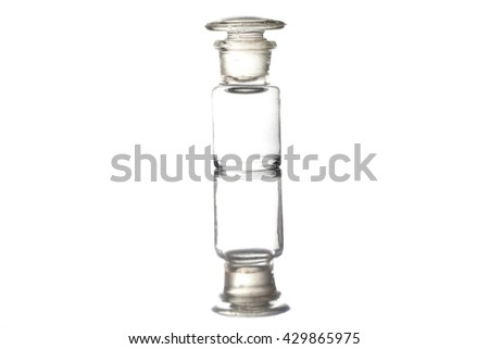 Vintage glass bottle isolated on white background with reflection - stock photo