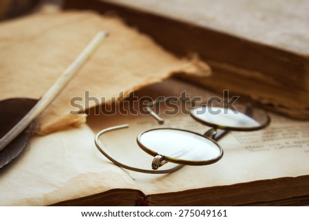vintage glasses and quill pen - stock photo
