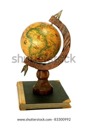 vintage globe on old book isolated on white background - stock photo