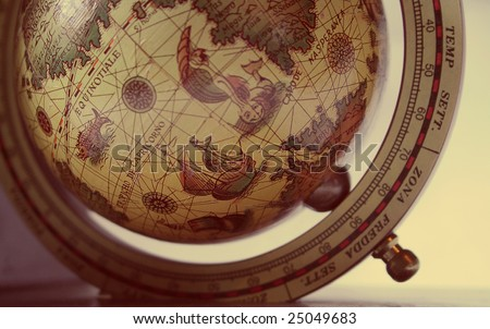 Vintage globe with illustrations and latin text - short depth of field. Shows Southern Atlantic Ocean region. - stock photo