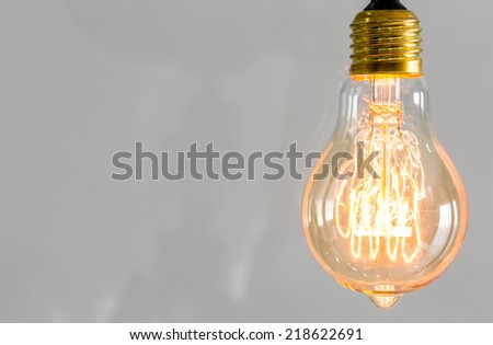 Vintage glowing light bulb - stock photo