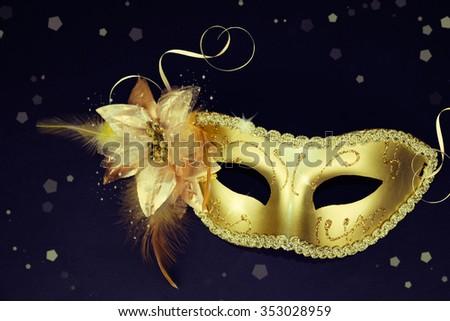 Vintage gold carnival mask on a dark background. - stock photo