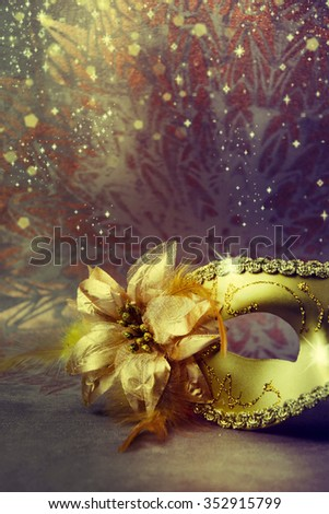 Vintage gold carnival mask on a gold background. - stock photo