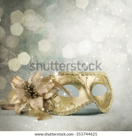 Vintage gold carnival maskon a turquoise background. - stock photo