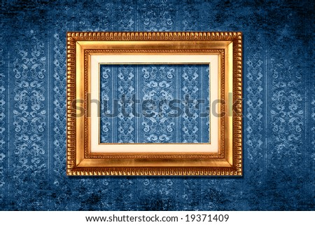 Vintage gold frame on blue grungy victorian wallpaper - stock photo