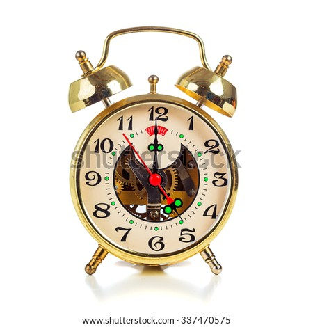 Vintage golden alarm clock on white background showing five o'clock - stock photo
