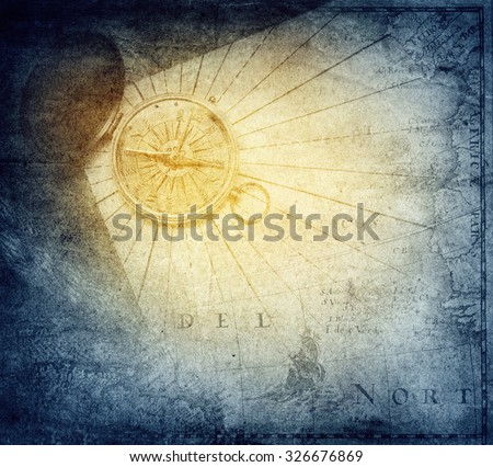 Vintage golden compass with nautical map background. - stock photo