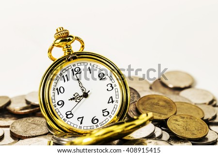 vintage golden pocket watch with stack coins isolated on white background.time money concept.