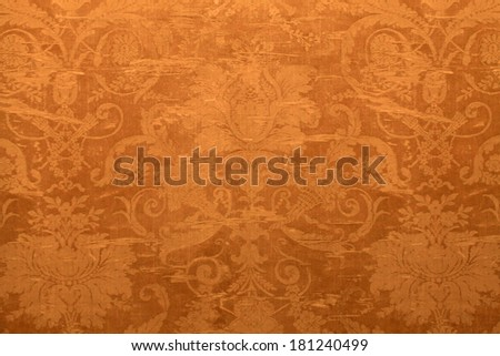 Vintage golden wallpaper with shabby tapestry victorian pattern - stock photo