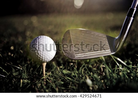 Vintage golf ball ready for shot - stock photo