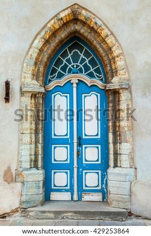 Vintage Gothic Door On A Medieval Building Facade