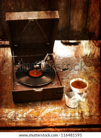 Vintage gramophone with a vinyl and cup of tea - stock photo