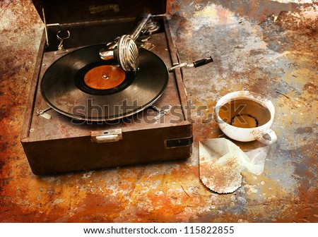 Vintage gramophone with a vinyland cup of tea - stock photo