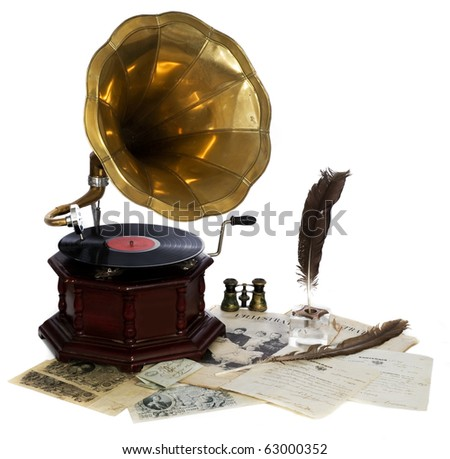vintage gramophone  with ancient letters and feather