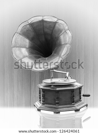 Vintage Gramophone with disc isolated on grunge background bell mouth - stock photo