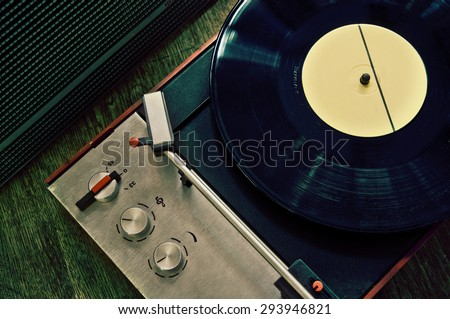 Vintage gramophone with vinyl record - ready to play - stock photo