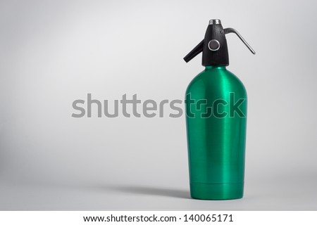 Vintage green seltzer siphon on grey background - stock photo