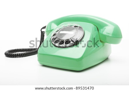 vintage green telephone isolated over white background - stock photo