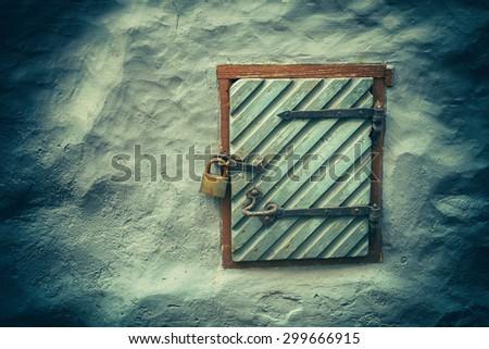 Vintage grunge background, wooden door in grunge concrete wall  - stock photo