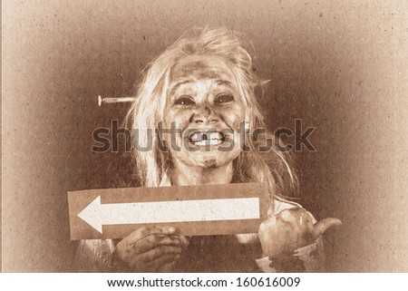 Vintage grunge monster holding arrow card of misdirection when pointing in the opposite direction