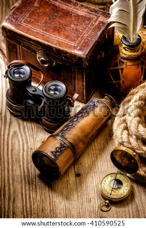 Vintage grunge still life. Antique items on wooden table. Travel geography concept.