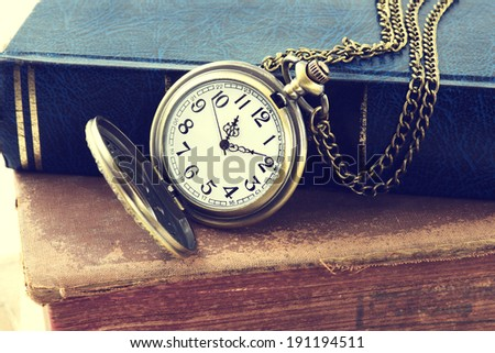 Vintage grunge still life with antique pocket watch, and old book    - stock photo