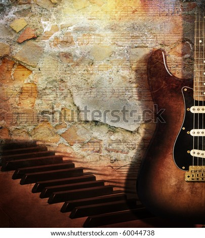 Vintage grunge style background With guitar and piano on brick wall - stock photo