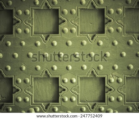 Vintage grunge wooden background door gate of the old castle detail with metal rivets - stock photo
