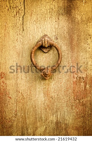 Vintage grungy image of ancient door knocker - stock photo