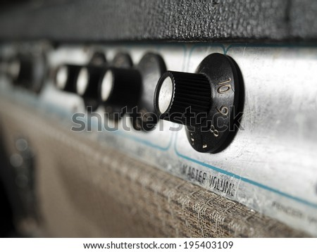 Vintage guitar amplifier closeup,focus on volume knob, for music,sound,entertainment themes - stock photo