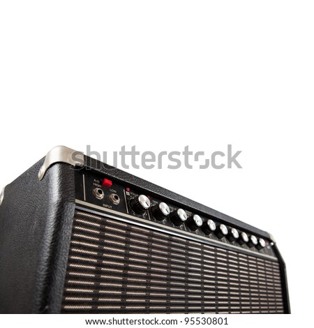 Vintage guitar amplifier, shot from low angle, isolated on white. - stock photo