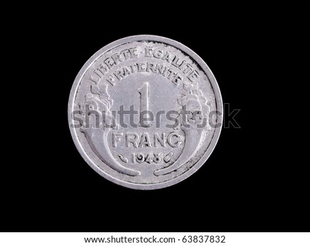 Vintage half  French Franc coin isolated on black