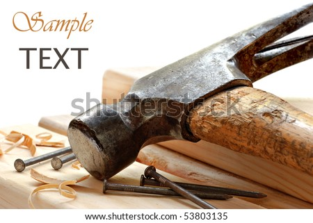 Vintage hammer with nails and wood on white background with copy space.  Macro with shallow dof. - stock photo