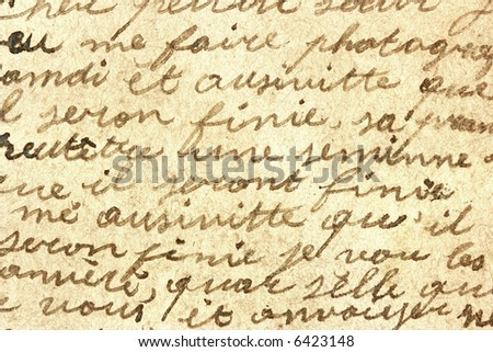 Vintage hand writing on a letter. Old paper with visible structure. Pen ink. - stock photo