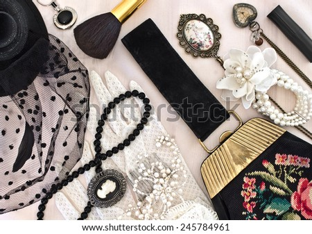 Vintage handbag, hat with a veil and women's jewelry and accessories - stock photo