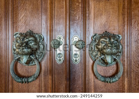 Vintage handles for doors. With a picture of a lion. - stock photo