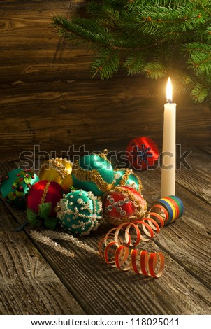 Vintage handmade Christmas decorations over wooden background - stock photo
