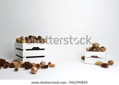 Vintage handmade craft christmas or new year 2016 rustic composition with fir cones isolated on a white background - stock photo