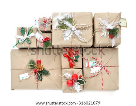Vintage handmade craft christmas or new year 2016 rustic presents gifts isolated on a white background - stock photo